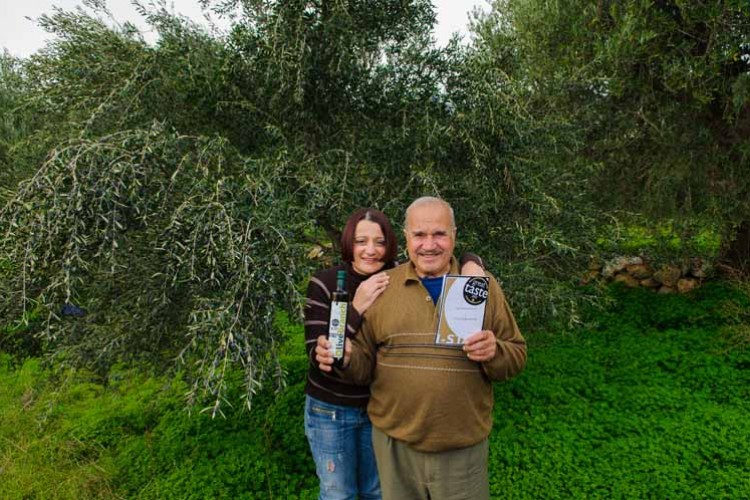 Maria and her father proudly holding the Great Taste Award