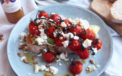 Toasted sourdough with hummus, avocado slices, baby vine tomatoes roasted in Olive Branch Fig Balsamic Dressing, feta and toasted pine nuts